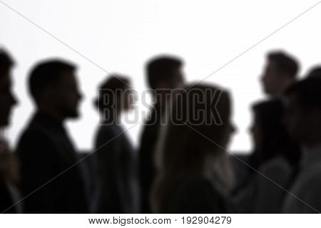 Crowd of anonymous people black silhouettes and white background
