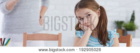 Worried girl with problems sitting sad at school