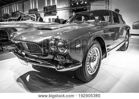 MAASTRICHT NETHERLANDS - JANUARY 14 2016: Grand Tourer car Maserati 3500 GTI Sebring 1962. Black and white. International Exhibition InterClassics & Topmobiel 2016