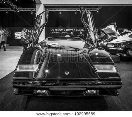 MAASTRICHT NETHERLANDS - JANUARY 14 2016: Sports car Lamborghini Countach 5000 Quattrovalvole 1987. Black and white. International Exhibition InterClassics & Topmobiel 2016