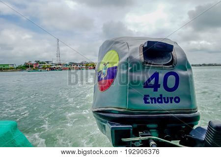 MUISNE, ECUADOR- MAY 06, 2017: Boat engine, wave trace visible on water from driving, great perspective and beautiful colours in Muisne Ecuador.