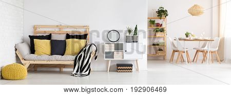 Scandi apartment interior with sofa and dining table