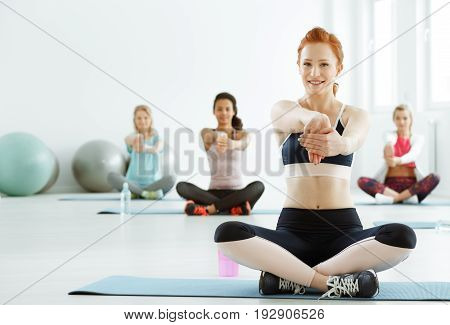 Young sportive women exercising during fitness classes