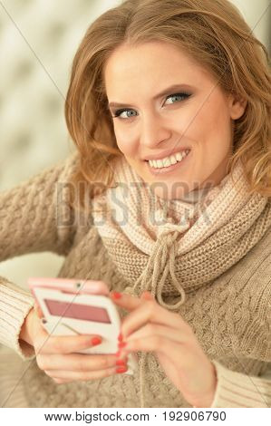Portrait of a young beautiful woman using smartphone