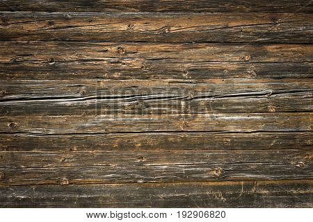 Rustic wood planks background of log cabin wall with nice studio lighting and elegant vignetting to draw the attention.