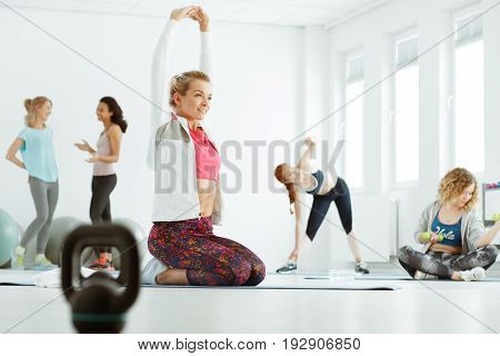 Group of women stretching before dance classes