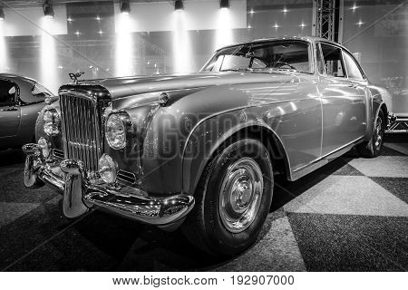 MAASTRICHT NETHERLANDS - JANUARY 14 2016: Luxury car Bentley Continental S2 1961. Boby by H. J. Mulliner. Black and white. International Exhibition InterClassics & Topmobiel 2016
