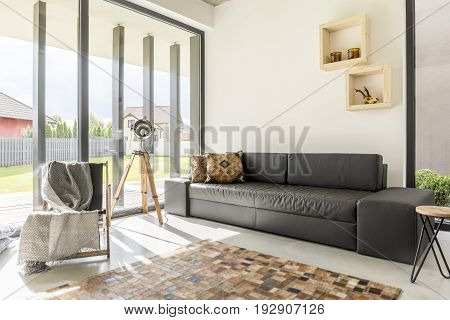 Light living room with sophisticated furnitures and enormous window