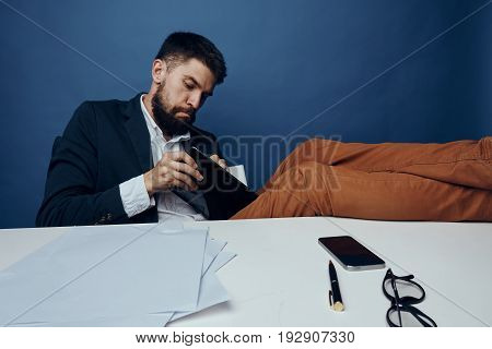 Businessman with a beard at his desk in the office.