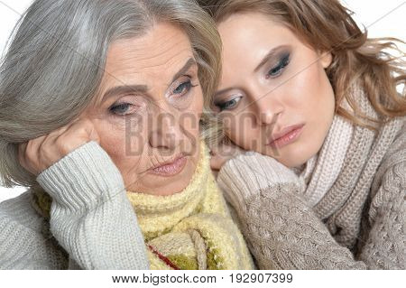 Portrait of thoughtful senior mother and her daughter