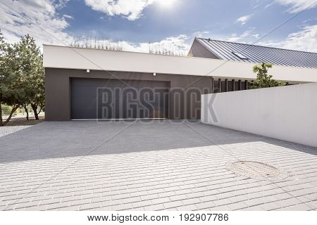 Modern concrete garage for couple cars with big driveway