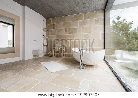 Amazing spacious bathroom with sand beige tiles
