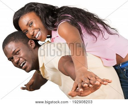 Beautiful young african couple looking at camera young adults arms outstretched