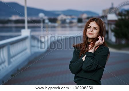 Portrait, young beautiful woman outdoors, sea, nature.