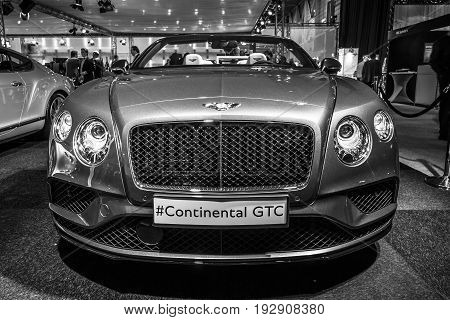MAASTRICHT NETHERLANDS - JANUARY 14 2016: Luxury car Bentley Continental GTC V8S since 2016. Black and white. International Exhibition InterClassics & Topmobiel 2016