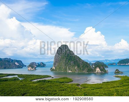 Landscape abundant nature tropical mangrove forest (intertidal forest) around limestone karst mountain sea blue sky white cloud. Nature conservation. Samet Nangshe viewpoint unseen Phang Nga Thailand