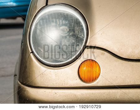 Detail of old car headlight. transport and city