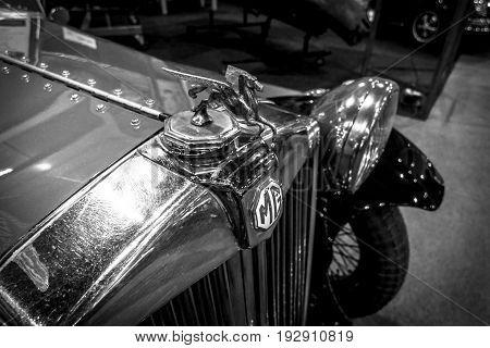 MAASTRICHT NETHERLANDS - JANUARY 14 2016: Hood ornament of a sports car MG J-Type 1932. Black and white. International Exhibition InterClassics & Topmobiel 2016