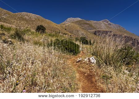 Hilly landscape with a footpath Lo Zingaro Nature Reserve in Sicily Italy