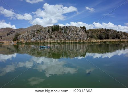 21ST DECEMBER 2016 PUNO PERU - A local fisherman on a boat to the Floating Islands on Lake Titicaca