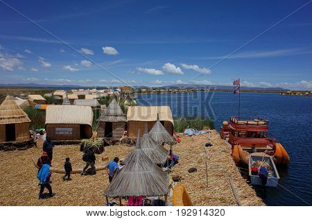 21ST DECEMBER 2016 PUNO PERU - Indigenous people at their village on the Floating Islands on Lake Titicaca