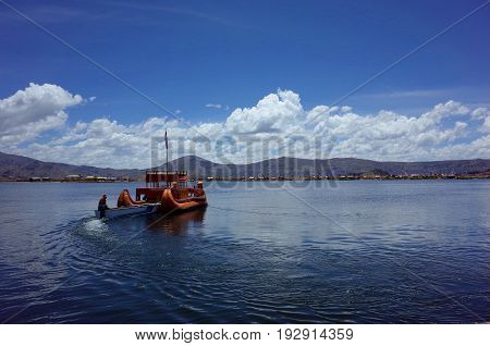 A Traditional Reed Boat At The Floating Islands On Lake Titicaca