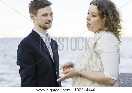 Woman tells something to a man (Saint Petersburg, Russia)