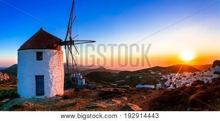 Idyllic landscape with windmills over sunset. Amorgos isalnd, Greece