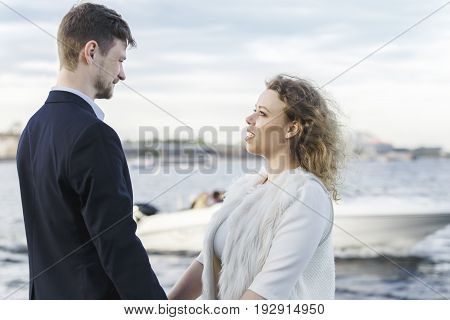Couple holding hands on the river bank