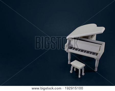 An Abstract Look at a Miniature White Grand Piano