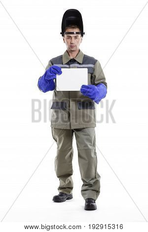 Portrait of a male welder with protective workwear over white background