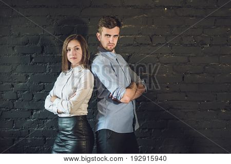 business team male and female formed of young businessmen standing over a dark background.