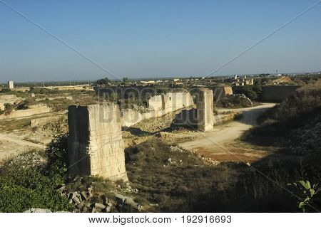 View of spectacular limestone quarry in Apulia
