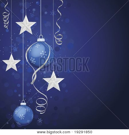 Blue ornaments and silver stars on deep blue background. Defocused background effect with snowflakes.