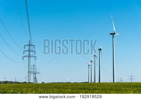 Wind turbines and power transmission lines seen in rural Germany