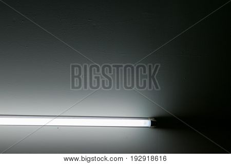 Detail of a fluorescent light tube on a wall. fluorescent light tube with copy space for any design