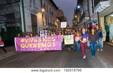 QUITO, ECUADOR- MAY 06, 2017: Woman holding a sign during a protest with the slogan alive we want them, protest against the femicide in Quito Ecuador.