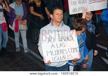 QUITO, ECUADOR- MAY 06, 2017: Unidentified man holding a sign during a protest against the femicide in Quito Ecuador.