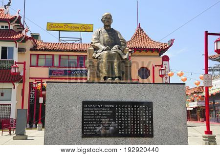 May 22 2017. Los Angeles California. The East Gate entrance to Los Angeles Chinatown in sunny california. Dr Sun Yat-sen sitting statue in the central plaza.