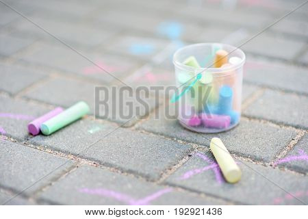Coloured Chalks On A Sidewalk
