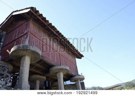 Horreo typical elevated granary in Combarro a village of the province of Pontevedra in the Galicia region of Spain.