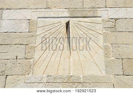 Sundial engraved on wall church in Pobra, Galicia, Spain