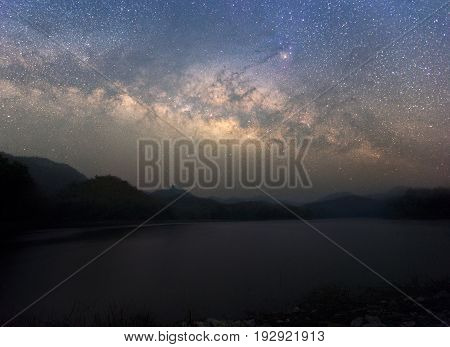 Beautiful Night Starry sky with Rising Milky Way over the mountain Thailand