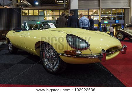 MAASTRICHT NETHERLANDS - JANUARY 14 2016: A sports car Jaguar E-Type Series 1 convertible 1964. International Exhibition InterClassics & Topmobiel 2016