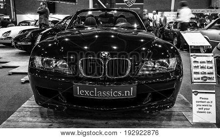 MAASTRICHT NETHERLANDS - JANUARY 14 2016: Compact luxury sports car BMW Z3M 1999. Black and white. International Exhibition InterClassics & Topmobiel 2016