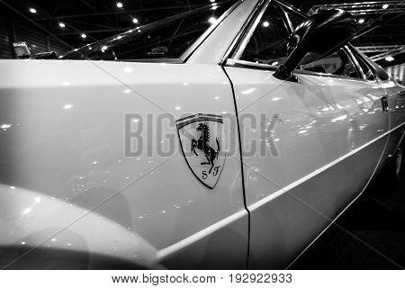 MAASTRICHT NETHERLANDS - JANUARY 14 2016: Fragment of a sports car Ferrari 308 GT4 Dino 1977. Black and white. International Exhibition InterClassics & Topmobiel 2016