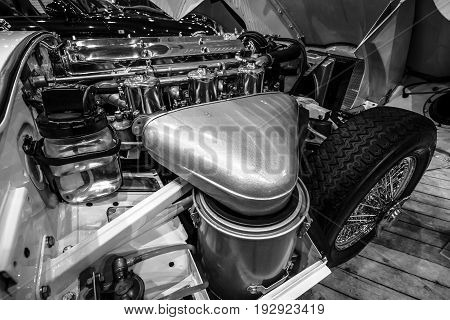 MAASTRICHT NETHERLANDS - JANUARY 14 2016: Engine compartment Jaguar E-Type Series 1 coupe 1963. Black and white. International Exhibition InterClassics & Topmobiel 2016