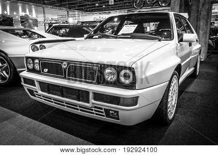 MAASTRICHT NETHERLANDS - JANUARY 14 2016: Sports car Lancia Delta HF Integrale 16v Evoluzione II 1993. Black and white. International Exhibition InterClassics & Topmobiel 2016