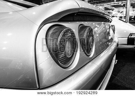 MAASTRICHT NETHERLANDS - JANUARY 14 2016: Stop lights of sports car Ferrari F355 GTS 1998. Black and white. International Exhibition InterClassics & Topmobiel 2016