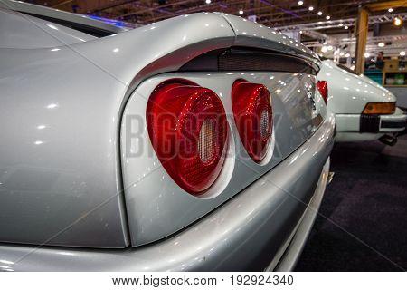 MAASTRICHT NETHERLANDS - JANUARY 14 2016: Stop lights of sports car Ferrari F355 GTS 1998. International Exhibition InterClassics & Topmobiel 2016